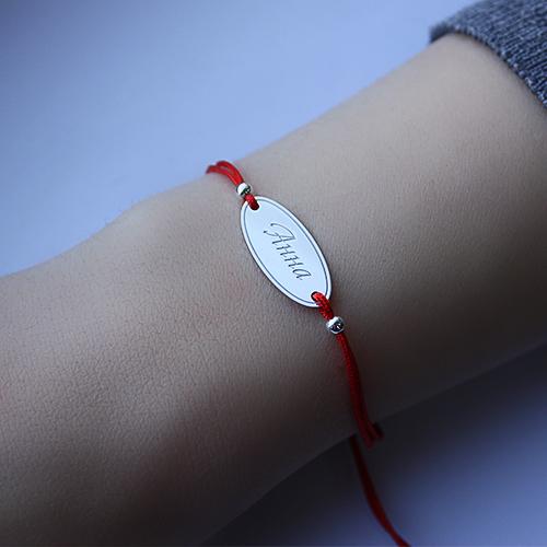 Браслет из красной шелковой нити с серебряной вставкой Анна 000008086 Анна