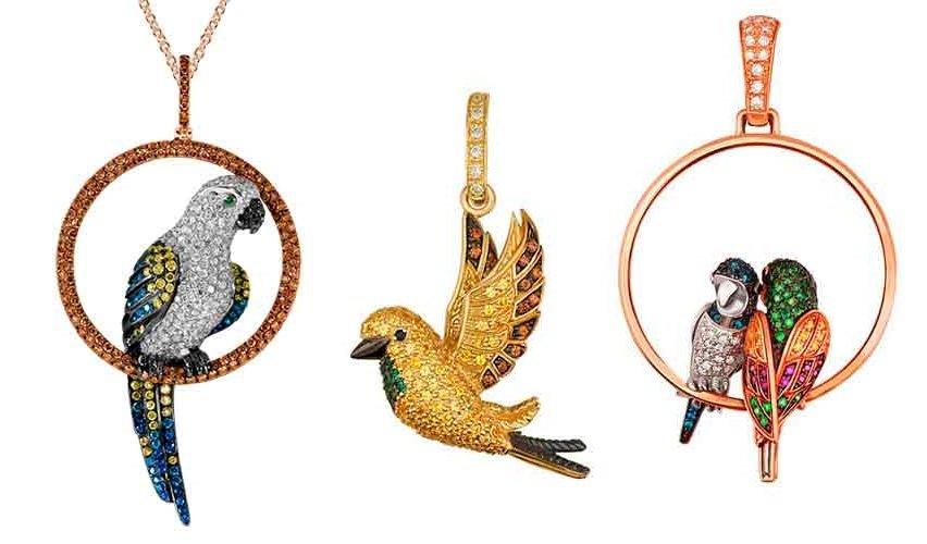 Золотые кулоны в виде птиц
