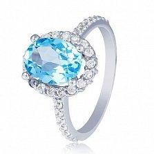 Золотое кольцо Альда в белом цвете с голубым топазом и фианитами