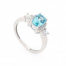 Золотое кольцо Августина в белом цвете с голубым топазом и белыми фианитами