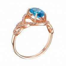 Золотое кольцо Каролина в красном цвете с голубым топазом и фианитами