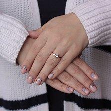 Золотое кольцо Simple Plan в красном цвете с завальцованным фианитом
