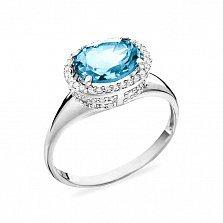 Золотое кольцо Илайн в белом цвете с голубым топазом и белыми фианитами