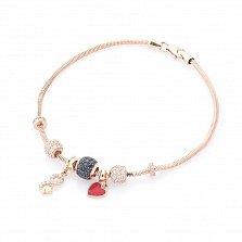 Золотой браслет с шармами Вечная любовь с красной эмалью, черными и белыми фианитами