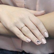 Золотое кольцо Лунный блеск с асимметричной шинкой и кристаллом Swarovski