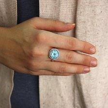 Серебряное кольцо Венера с голубым топазом и фианитами