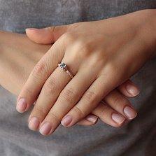 Золотое кольцо Шарлотта с голубым топазом и фианитами