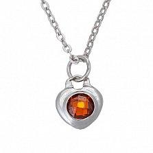 Серебряное колье Огонь в сердце с красным фианитом шахматной огранки