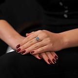 Золотое кольцо Фаина в белом цвете с голубым топазом и фианитами