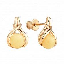 Позолоченные серебряные серьги-пуссеты Очарование с переплетеными элементами и лимонным янтарем
