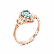 Кольцо в красном золоте Лолита с голубым топазом и фианитами
