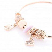 Золотой браслет с шармами Гламурчик с фианитами и розовым полимером