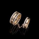 Двойное золотое кольцо Картье с фианитами