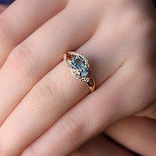 Золотое кольцо Дианис с голубым топазом и фианитами