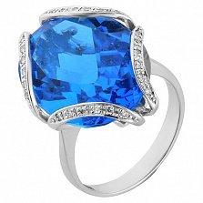 Золотое кольцо Гассия с голубым топазом и бриллиантами