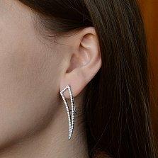 Серебряные серьги-подвески Стильные клыки с дорожками циркония
