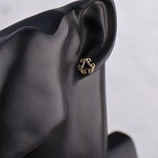 Золотые серьги-пуссеты Загадка с черными агатами треугольной формы и зелеными нанокристаллам