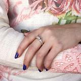 Серебряное кольцо Сателлит с золотыми накладками и цирконием