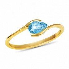 Золотое кольцо Тонкие грани в желтом цвете с голубым топазом