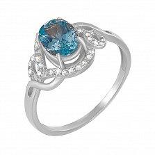 Кольцо из белого золота с голубым топазом и фианитами 000131320