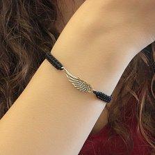 Черный текстильный плетеный браслет Крыло со вставкой из серебра и золотой накладкой