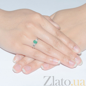 Серебряное кольцо Нюша с изумрудом и фианитами 000015308