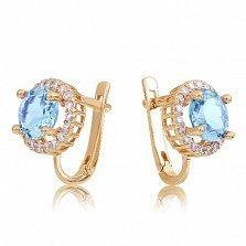 Золотые серьги София с голубыми топазами и фианитами