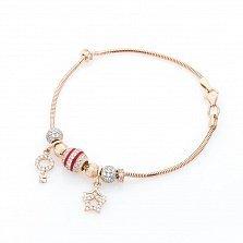 Золотой браслет Юность с шармиками и подвесками в форме ключика и звезд с эмалью и фианитами