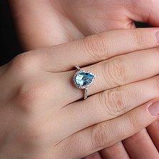 Золотое кольцо Виктория в белом цвете с голубым топазом и фианитами