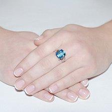 Кольцо из белого золота Атланта с голубым топазом и цирконием