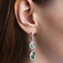 Серебряные серьги Плавающие камни с зелеными и белыми фианитами