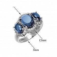 Серебряное кольцо Аврора с голубым топазом Swiss Blue и фианитами