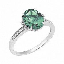 Кольцо в белом золоте Оксана с синтезированным зеленым кварцем и фианитами