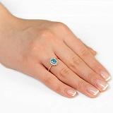 Золотое кольцо Ванесса с голубым топазом и фианитами