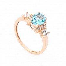 Золотое кольцо Августина в красном цвете с голубым топазом и белыми фианитами