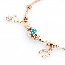 Золотой браслет Юность с шармиками и подвесками в форме бабочки и подковки с эмалью и фианитами