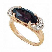 Золотое кольцо Тамила с синтезированным александритом и фианитами