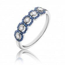Золотое кольцо Арин в белом цвете с узорной шинкой, завальцованными бриллиантами и сапфирами
