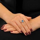 Золотое кольцо Альда с голубым топазом и фианитами