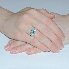 Серебряное кольцо Мирта с золотой вставкой и голубым цирконием