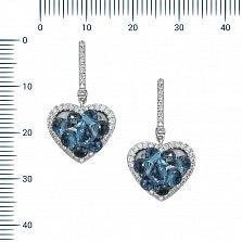 Золотые серьги-подвески Ледяное сердце в белом цвете с дорожками бриллиантов и голубыми топазами