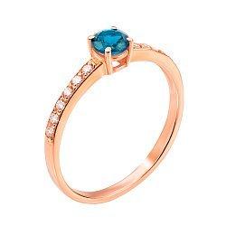 Золотое кольцо в красном цвете с голубым топазом и фианитами 000117190