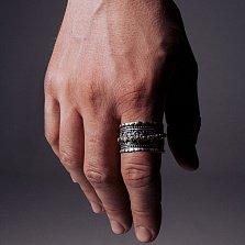 Серебряное черненое кольцо-антистресс Karma с подвижной золотой накладкой