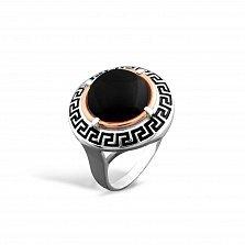 Серебряное кольцо Египтянка с золотой накладкой, имитацией оникса и черной эмалью