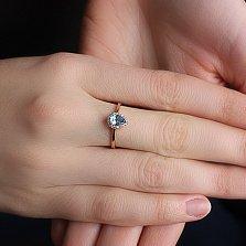Золотое кольцо Инесса с голубым топазом и цирконием