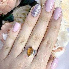 Серебряное кольцо Солярис с янтарем и разомкнутой шинкой
