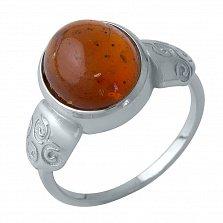 Серебряное кольцо Хилини с янтарем и узорами на шинке