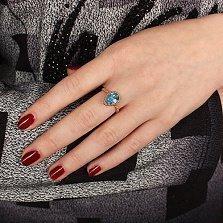 Золотое кольцо Юджиния с голубым топазом