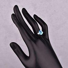 Серебряное кольцо Антония с голубым топазом и фианитами