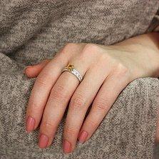 Серебряное кольцо Символ величия с желтым и белым цирконием